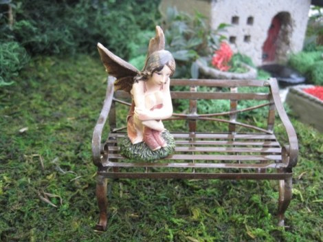 Detail picture of a fairy sitting on her bench