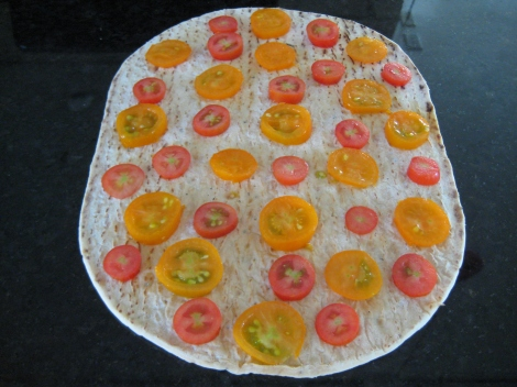 Tomatoes sliced on Italian Herb Flat Bread