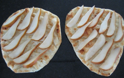 Sliced pears on flat bread