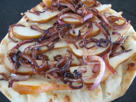 Caramelized onions on pear and flat bread